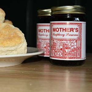 2 small bottles of raspberry preserve and bread